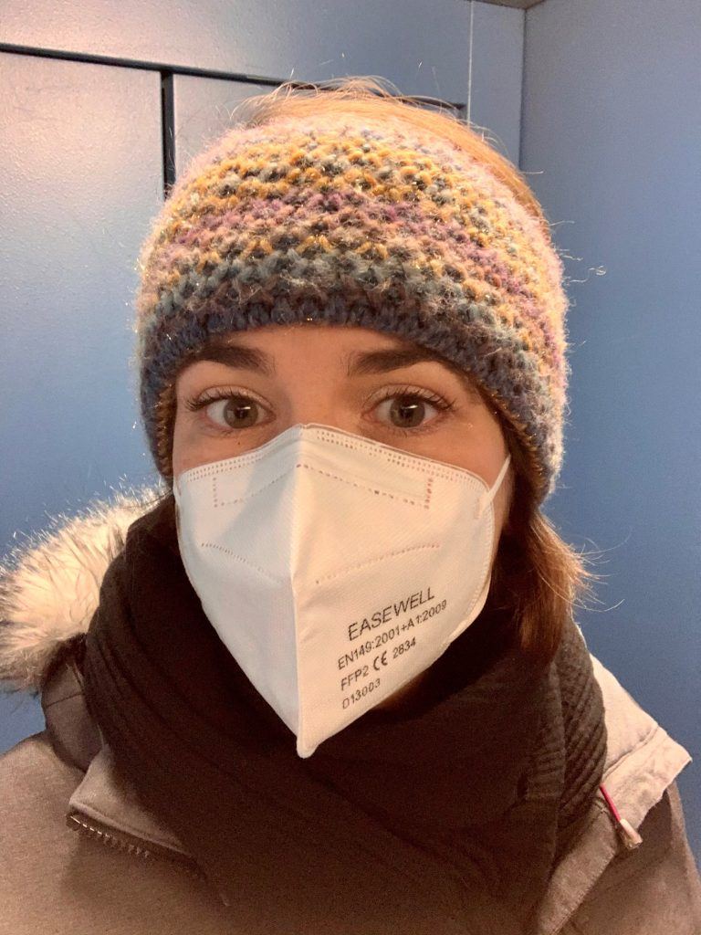 Wearing a protective mask while travelling to the office.